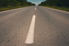 View of asphalt road, blue sky and sun. Royalty Free Stock Photos