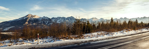 View from asphalt road to mountain tops. royalty free stock photos