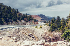 View of a asphalt road that video to the mountains Royalty Free Stock Image