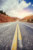 View of a asphalt road that video to the mountains Royalty Free Stock Photos