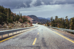 View of a asphalt road that video to the mountains Royalty Free Stock Photo