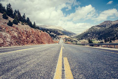 View of a asphalt road that video to the mountains Stock Photo