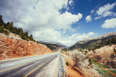 View of a asphalt road that video to the mountains Royalty Free Stock Photography