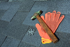 View on Asphalt Roofing Shingles Background. Roof Shingles - Roofing. Asphalt Roofing Shingles Hammer, Gloves and Nails Stock Photos