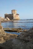View of astura tower. Torre astura the castle near Rome immersed in the sea Stock Photo
