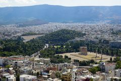 View of Athens city from Acropolis showing ancient ruin, buildings architecture,urban streets, green trees and mountain background Royalty Free Stock Image
