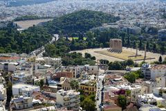 View of Athens cityscape from Acropolis showing ancient ruin, buildings architecture, urban streets, green trees and white city Stock Photo