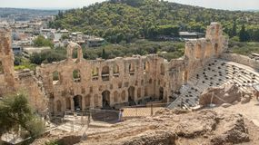 View of Athens cityscape through ancient stone theatre, Greece stock photography