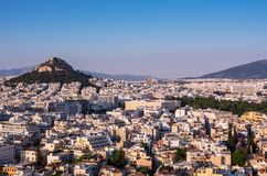 View of Athens, Greece and mount of Lycabettus from Acropolis at sunset stock image