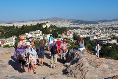 View of Athens Skyline, Greece. A number of tourists viewing Athens skyline and high density inner suburbs from the Areopagus hill, a small marble outcrop beside stock photos