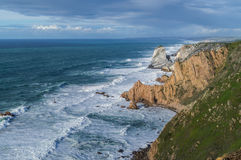 The view of Atlantic ocean with cliffs and rocks,near Cabo da Roca,the western point of Europe,Portugal. Royalty Free Stock Photos