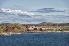 View from the Atlantic road to small red houses in the ocean, Norway Stock Photo