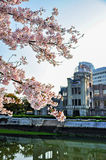 View of the Atomic Dome through cherry blossom in Hiroshima, royalty free stock photography