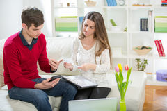 View of an Attractive couple doing administrative paperwork. Selective focus stock photos