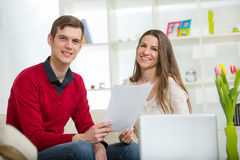 View of an Attractive couple doing administrative paperwork Stock Image