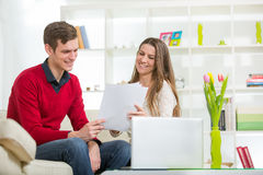 View of an Attractive couple doing administrative paperwork Stock Images