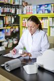 View of an attractive pharmacist at work stock images