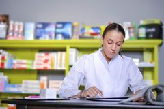 View of an attractive pharmacist at work royalty free stock photo