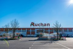 View of Auchan supermarket logo and entrance.