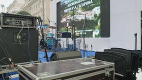 View of audio equipment on stage ready for busked concert during city festival. Writing `870 Moscow` on back of stage. View of audio equipment on scene ready for stock video footage