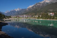 View of Auronzo di Cadore Belluno Italy the Lake Santa Caterina and Tre Cime Peaks. Mountains royalty free stock images