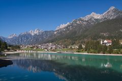 View of Auronzo di Cadore Italy the Lake Santa Caterina and Tre Cime Peaks Dolomites. Mountains stock photography