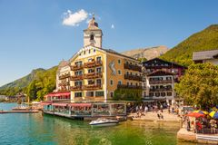 View of austrian alpine town St.Wolfgang on Wolfgangsee lake from a boat Royalty Free Stock Images