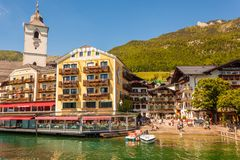 View of austrian alpine town St.Wolfgang on Wolfgangsee lake from a boat Stock Photo