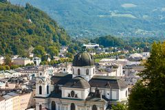 View of the Austrian city of Salzburg and the Dome church, with. Other buildings, mountains and forest royalty free stock photo