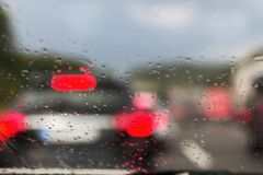 View on Autobahn traffic through a wet windshield royalty free stock photography