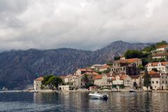 View on autumn Bay in the town of Perast, boat and Suzuki fire truck during the grape harvest festival. Perast, Montenegro - September 13: view on autumn Bay in Royalty Free Stock Image