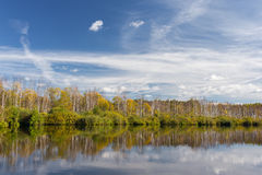 View of the autumn forest from the water Stock Photography