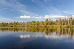 View of the autumn forest from the water Royalty Free Stock Images