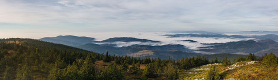 View from the autumn mountains into the valley with low clouds Royalty Free Stock Photo