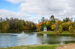 View of an autumn park with colorful leaves. And a pond in the foreground Stock Photography