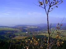 The view of the autumn upland. Looking forward from the peak. The autumn in the upland royalty free stock photo