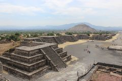 View of the Avenue of the Dead and the Pyramid of the Sun in the city of Teotihuacan. View of the Avenue of the Dead and the Pyramid of the Sun, from the Pyramid stock photo