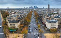 View of avenue des Champs Elysees in Paris from the Arc de Triom. Panoramic view of Paris from the Arc de Triomphe. Autumn. Rain. Sun Royalty Free Stock Photo