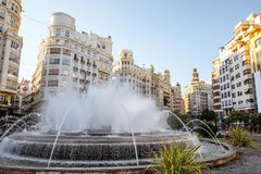 Valencia city in Spain. View on the Ayuntamiento square with fountain and beautiful buildings in Valencia city in Spain Stock Photography