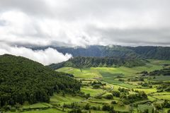 View of Azores Calderas. A road past beautiful pastures and two volcanic calderas in Sete Cidades, Sao Miguel royalty free stock photography