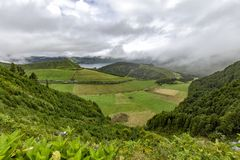 View of Azores Pastures. View of calderas and lakes at the edge of the Sete Cidades Caldera on the island of Sao Miguel in the Azores stock photo