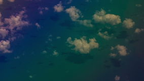 View Azure Sea through Clouds from Airliner Window stock video
