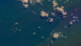 View Azure Sea through Clouds from Airliner Window stock footage