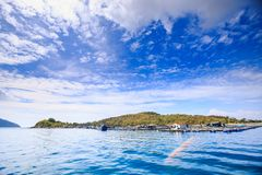 View of Azure Sea Green Hill Island Sky Stock Image