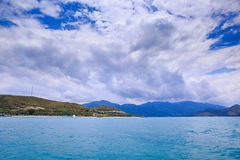 View of Azure Sea Islands Green Hills Sky Clouds Royalty Free Stock Photography