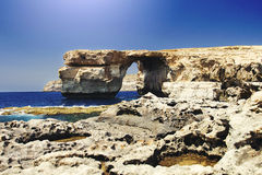 View of the Azure Window in Malta. Azure Window is a Limestone natural arch on the Maltese island of Gozo. It is situated near Dwejra Bay on the Inland Sea. The Royalty Free Stock Image