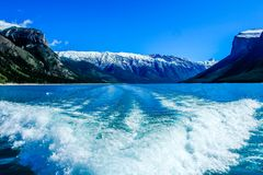 View from the back of the boat. On Lake Minnewanka, Banff National Park, alberta, Canada Royalty Free Stock Photography