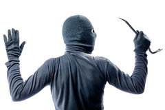 View from the back of a criminal in a balaclava with his hands. Raised on a white background Royalty Free Stock Image