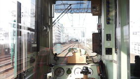 View from the back of a Japan Rail train on the Kansai line as it travels through a rural area. Window of local Japanese train wit stock footage
