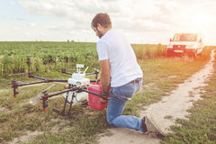 View from the back process of preparing agro drones for irrigation. Royalty Free Stock Images
